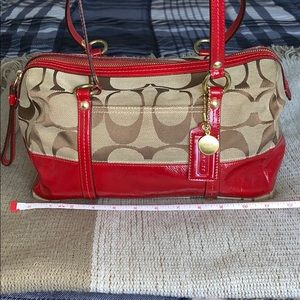 Coach signature canvas satchel with red trim